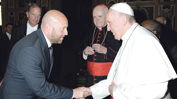 Roberto Buontempo greeted by Pope Francis. Cardinal O'Brien looks on.