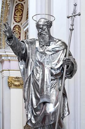 The textural characteristics of the saint's liturgical vestments are now more defined. Below: When all the silver plates were removed, a wood carved statue of St Philip emerged.