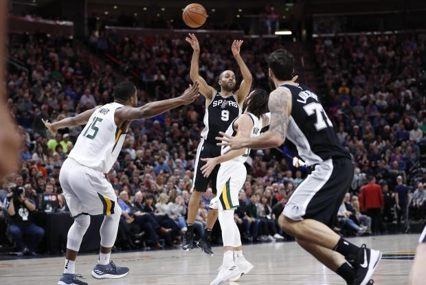 San Antonio Spurs guard Tony Parker (9) passes to center Joffrey Lauvergne (77) against Utah Jazz forward Derrick Favors (15) and guard Ricky Rubio (3) in the fourth quarter at Vivint Smart Home Arena. Photo: Jeff Swinger-USA TODAY Sports