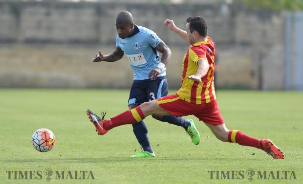 Sliema's Demi Dos Santos (left) makes his way past Senglea's Pablo Doffo during their FA Trophy match at Hibernians Stadium in Paola on February 18. Photo: Matthew Mirabelli