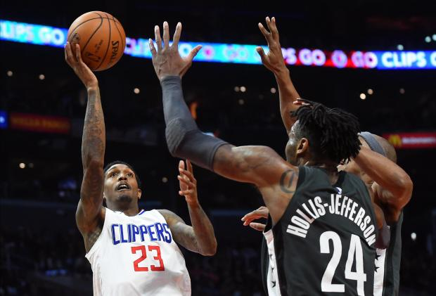 Los Angeles Clippers guard Lou Williams (23) scores over Brooklyn Nets forward Rondae Hollis-Jefferson (24) in the second half at Staples Center. Photo Credit: Jayne Kamin-Oncea-USA TODAY Sports