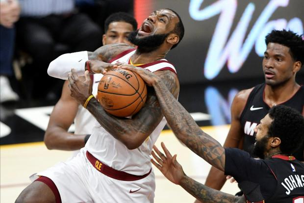 Cleveland Cavaliers forward LeBron James (23) drives to the basket beside Miami Heat forward James Johnson (16) and forward Justise Winslow (20) in the second quarter at Quicken Loans Arena. Photo: David Richard-USA TODAY Sports