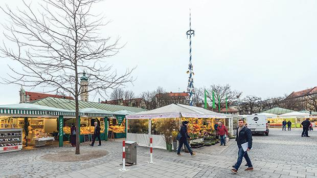 Close up of the maypole at the Viktualienmarkt, Munich which is situated in between market stalls and which is a famous point of interest for all visitors of Bavaria.