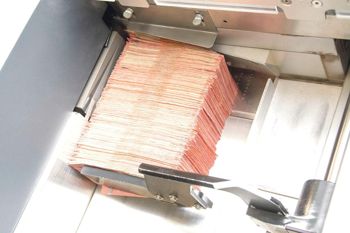 Banknotes in a note-processing machine.