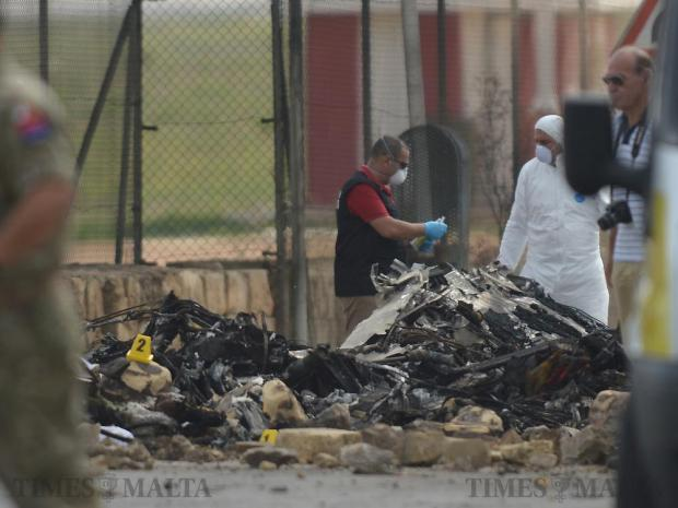 Members of the Forensic team sift through the wreckage of a small twin-engine aircraft after crashing just after take off on October 24. Photo: Matthew Mirabelli
