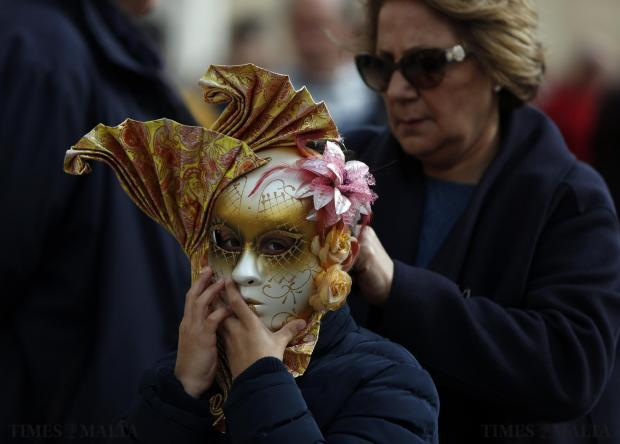 A child has his mask adjusted during carnival festivities in Valletta on February 7. Photo: Darrin Zammit Lupi