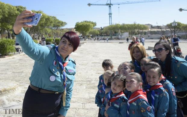 Girl Guides take a photo moments before the start of the annual Scout and Girl Guides Parade in Valletta on April 23. Photo: Mark Zammit Cordina