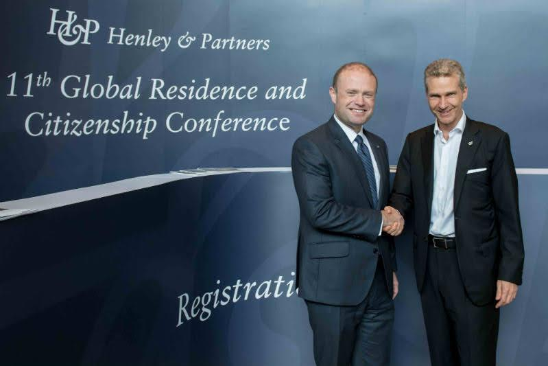 Former Prime Minister Joseph Muscat shakes hands with Henley & Partners chairman Christian Kalin during an international citizenship conference. Photo: Chriskalin.com