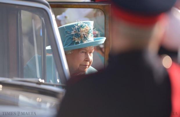 Queen Elizabeth makes her way out of her car after arriving at Malta International Airport on November 28. The Queen and her husband Prince Philip were in Malta on an official state visit which included the opening ceremony of the Commonwealth Heads of Government Meeting. Photo: Matthew Mirabelli
