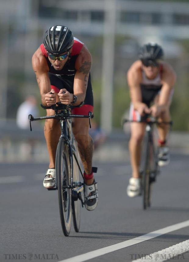 An athlete completes his final loop of the bike segment of the National Triathlon Championships in Salina on October 2. Photo: Matthew Mirabelli