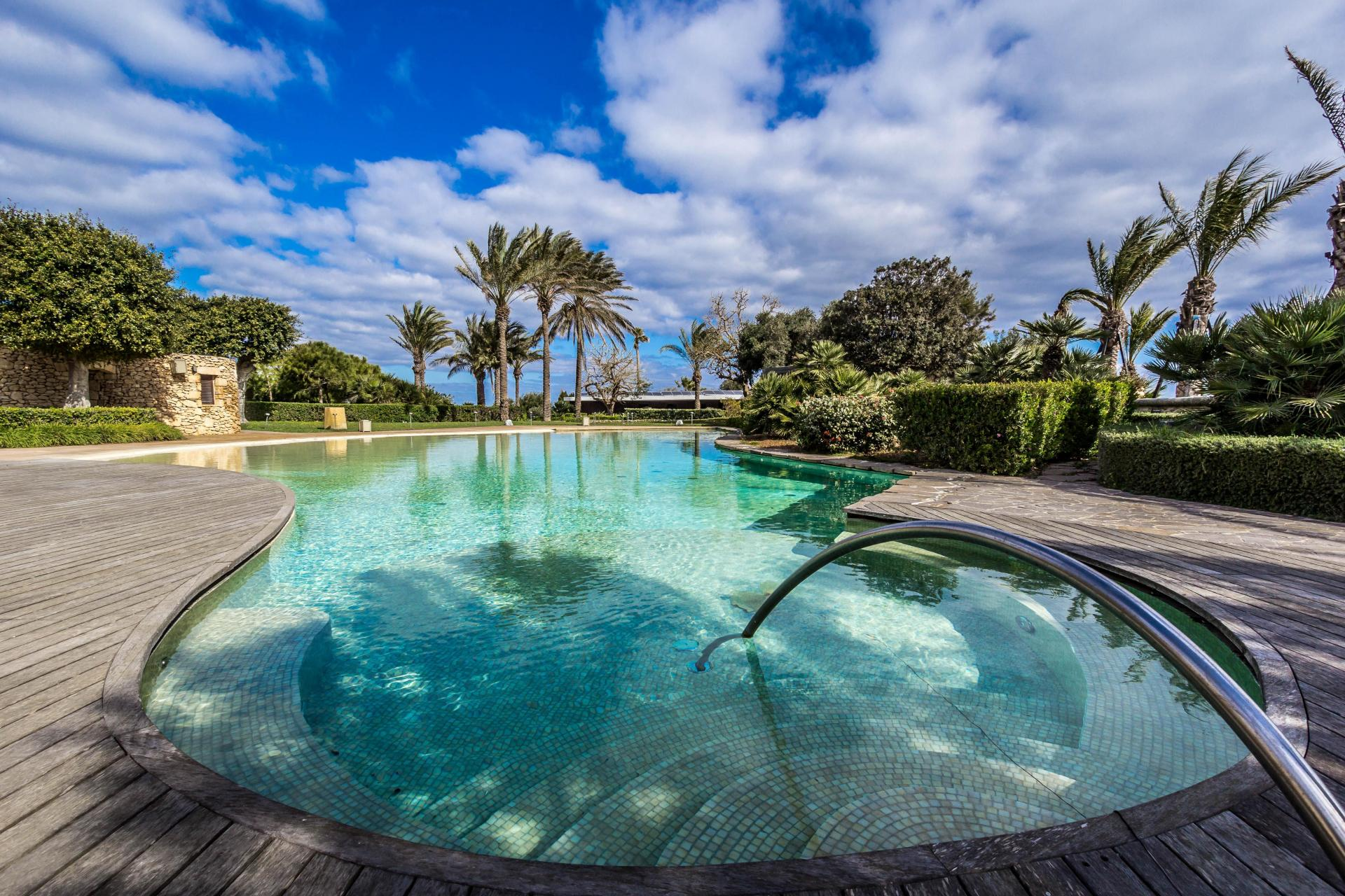 A large pool and deck at this Lija villa.