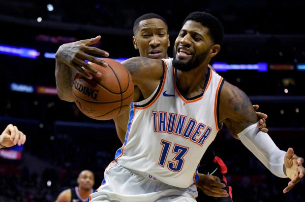 Oklahoma City Thunder forward Paul George (13) is guarded by LA Clippers forward Wesley Johnson (33) in the second half at Staples Center. Photo: Kirby Lee-USA TODAY Sports