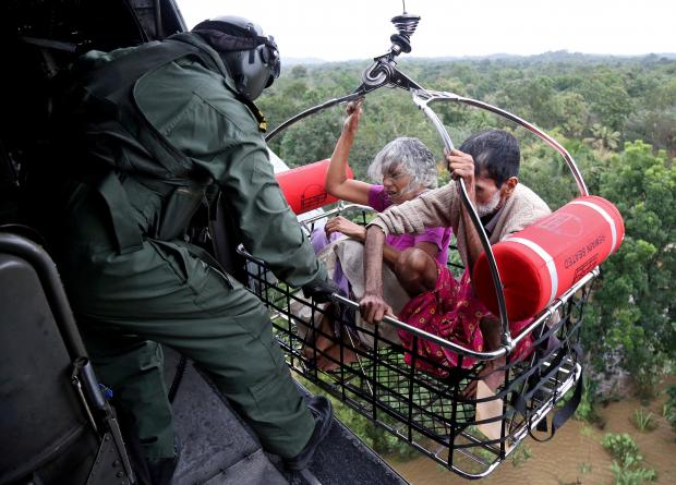 People airlifted to safety in Kerala. Photo: Reuters