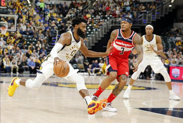 Indiana Pacers guard Tyreke Evans (12) drives to the basket against Washington Wizards guard Brad Beal (3) during the third quarter at Bankers Life Fieldhouse. Mandatory Credit: Brian Spurlock-USA TODAY Sports