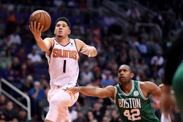 Phoenix Suns guard Devin Booker (1) drives the ball in front of Boston Celtics center Al Horford (42) at Talking Stick Resort Arena. The Boston Celtics won 116-109 in overtime. Mandatory Credit: Jennifer Stewart-USA TODAY Sports