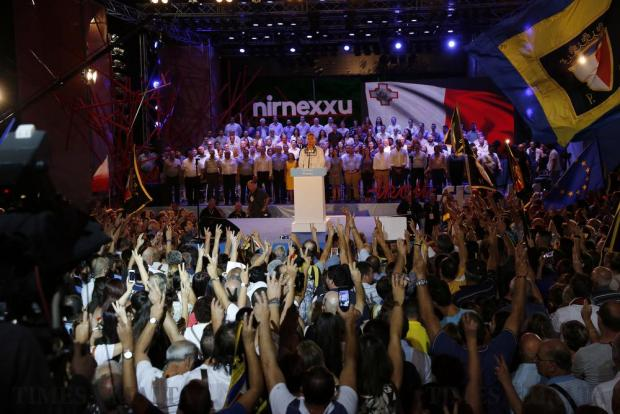 Supporters sing the national anthem before Nationalist Party and Opposition leader Simon Busuttil (centre) addresses a mass meeting to mark Independence Day on the Granaries in Floriana on September 20. Photo: Darrin Zammit Lupi