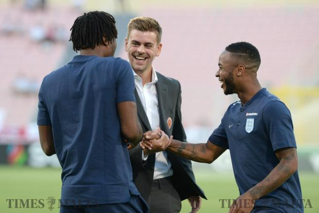 Malta's Sam Magri (centre) meets with his ex teammates Nathaniel Chalobah and Raheem Sterling, before the Malta England qualifying match at the National Stadium in Ta'Qali on September 1. The three players formed part of the 2011 England U-17 squad in which England were eliminated against Germany. Photo: Matthew Mirabelli
