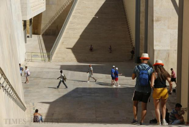 Tourists walk down the staircase at City Gate in Valletta on July 16. Photo: Darrin Zammit Lupi