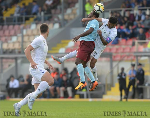 Gzira's Emmanuel Okoye, (centre) and John Mintoff (right) compete for the ball during their BOV Premiership match at The Hibernian's Stadium in Paola on November 25. Photo: Matthew Mirabelli
