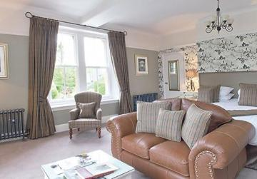 A non-pudding theme room, called The Cotswold Room, featuring the famous Cotswold Lion Sheep, at the Three Ways House Hotel.