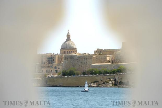 A dinghy sails around Marsamxett harbour on May 20. Photo: Matthew Mirabelli