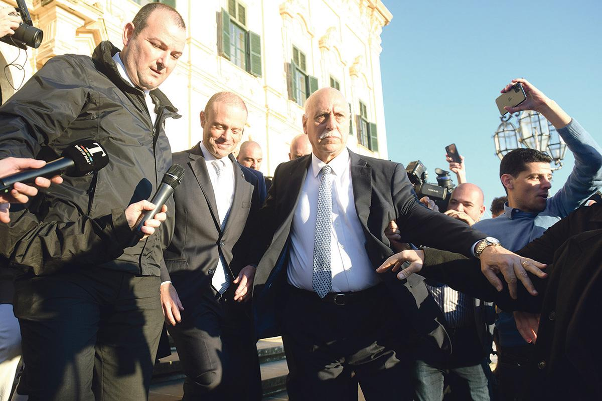 Prime Minister Joseph Muscat is escorted from Castille to Parliament.