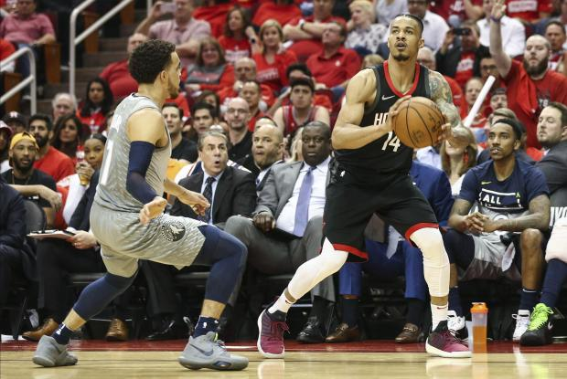 Houston Rockets guard Gerald Green (14) shoots the ball as Minnesota Timberwolves guard Tyus Jones (1) defends during the third quarter in game two of the first round of the 2018 NBA Playoffs at Toyota Center. Photo Credit: Troy Taormina-USA TODAY Sports