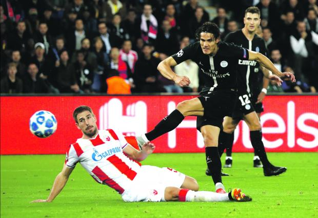 Edinson Cavani shoots at goal against Red Star Belgrade.