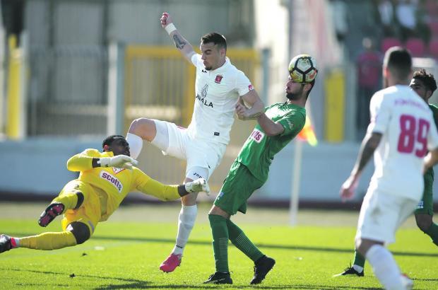 Floriana goalkeeper Ini Akpan clears the ball away against Valletta. Photo: Darrin Zammit Lupi