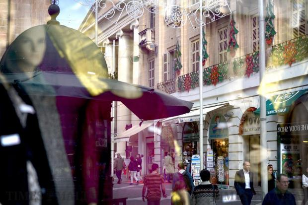 Festive Christmas reflections in a shop window in Valletta on November 29. Photo: Matthew Mirabelli
