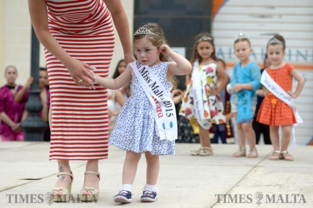 A young girl, accompanied by her mother models on stage during the Fish Festival in Zurrieq held on June 5. Photo: Matthew Mirabelli