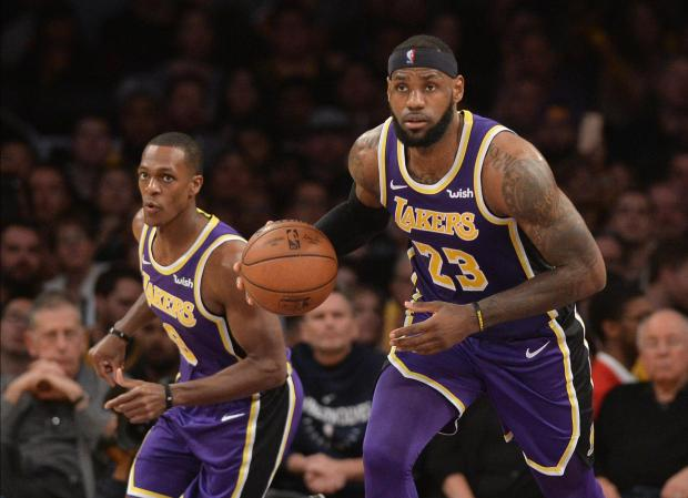 Los Angeles Lakers forward LeBron James (23) brings the ball up court against the Minnesota Timberwolves in the second half at Staples Center. Mandatory Credit: Richard Mackson-USA TODAY Sports
