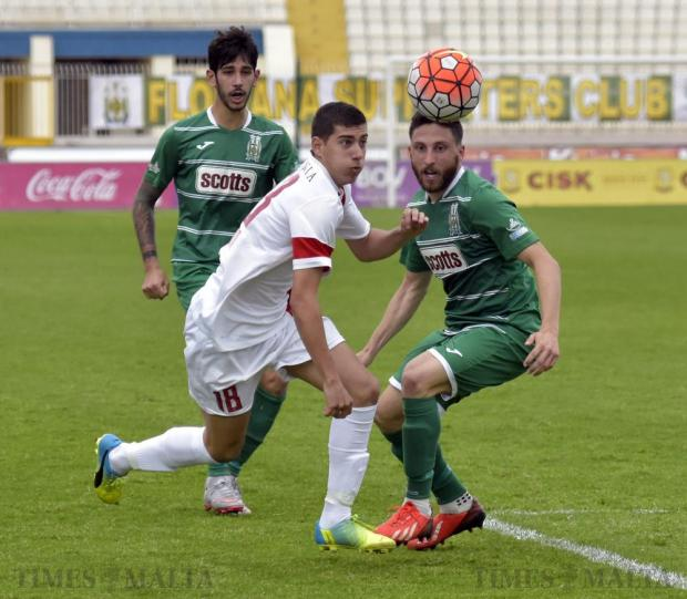 Valletta's Jurgen Suda and Floriana's Andre Scicluna try to get the ball during their Premier League derby match at the National Stadium in Ta' Qali on April 9. Photo: Mark Zammit Cordina