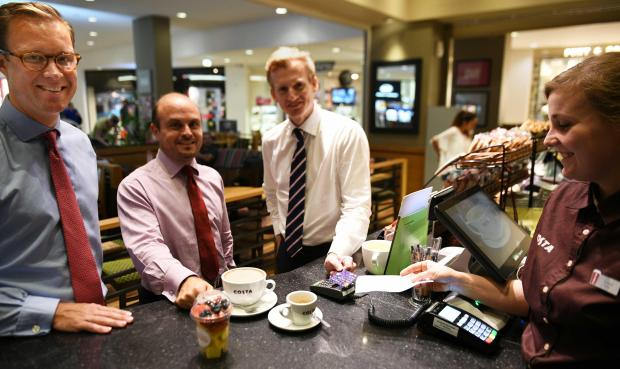 (from left) HSBC Malta Head of Retail Banking and Wealth Management Daniel Robinson, Head of Customer Value Management Sergio Bellizzi, and CEO Andrew Beane making the first HSBC Malta contactless payment.