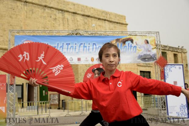 A woman performs Tai chi with a paper fan at Castile square in Valletta on April 29, as part of the World International Tai Chi day. Photo: Mark Zammit Cordina