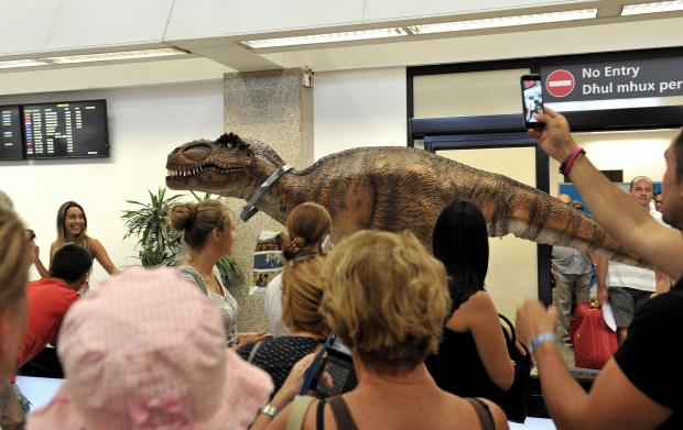 The Arrivals Lounge of the Malta International Airport welcomed Dino, an actor wearing an animatronic dinosaur suit on July 26. The dinosaur is part of a promotional campaign for a new game by online gaming company Pragmatic Play. Photo: Chris Sant Fournier