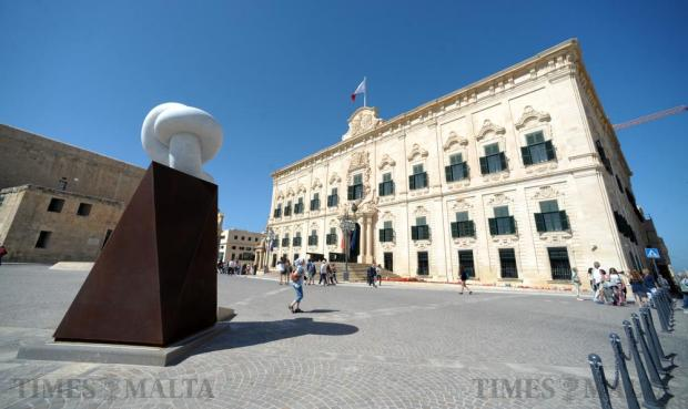 Tourists enjoy the hot weather and sun at Castille Place in Valletta on April 15. Photo: Matthew Mirabelli