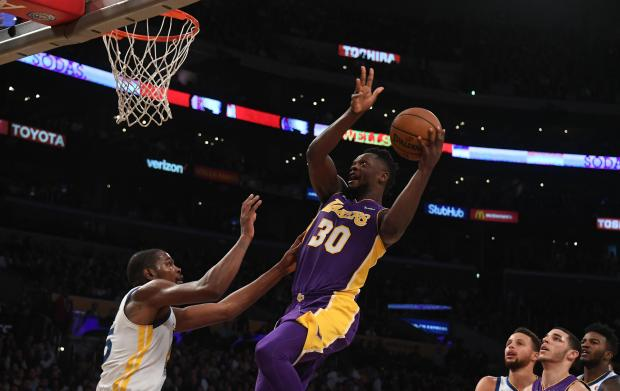 Los Angeles Lakers forward Julius Randle (30) shoots over Golden State Warriors forward Kevin Durant (35) during the second half at Staples Center. Photo: Richard Mackson-USA TODAY Sports