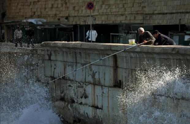 A fisherman casts his rod at 'il-Fossa' in Valletta on December 6. Photo: Chris Sant Fournier