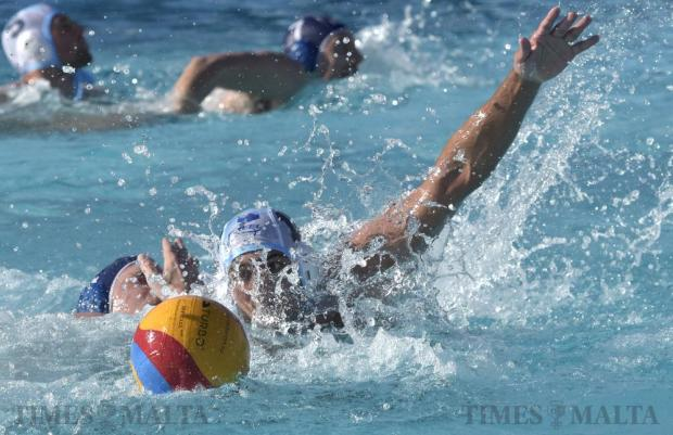 Sliema's John Brownrigg dashes to get the ball during the waterpolo match against Valletta at the National Pool in Tal-Qroqq on March 12. Photo: Mark Zammit Cordina