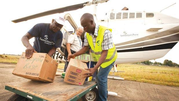 Samaritan's Purse team members help deliver supplies used to treat patients with Ebola in Liberia . Photo:Reuters