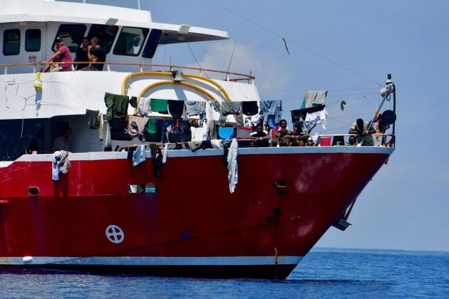 Migrants claim rights breach when they were detained on boats for weeks
