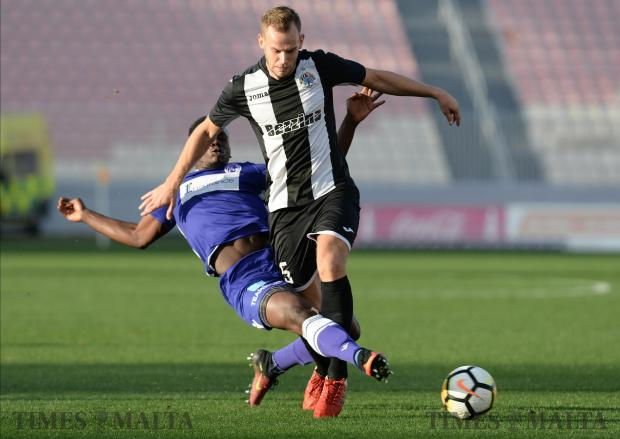Hibernians Martin Kreuzriegler (right) tries to make his way past St Andrew's Kevaughn Atkinson during their BOV Premier League match at the National Stadium in Ta'Qali on December 17. Photo: Matthew Mirabelli