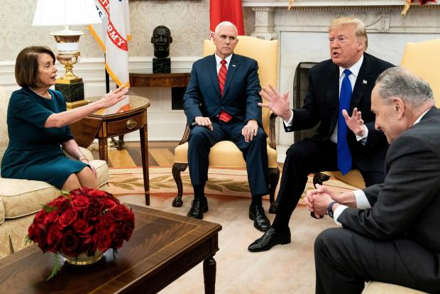 In this file photo taken on December 11, 2018 US Vice President Mike Pence (2L) listens while Democratic US Representative Nancy Pelosi (L), US President Donald Trump (2R) and Democratic Senate Minority Leader Charles Schumer argue about the impending government shutdown during a meeting at the White House in Washington, DC.