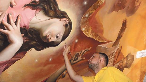 Manuel Farrugia hard at work on the section of the massive painting that features a portrait of the Virgin.