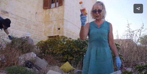 A video still showing one of the foreigners taking part in the clean-up.
