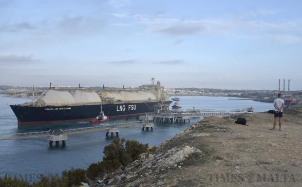 A man looks at the controversial LNG tanker Armada Meditterana at Delimara on October 10. Photo: Mark Zammit Cordina