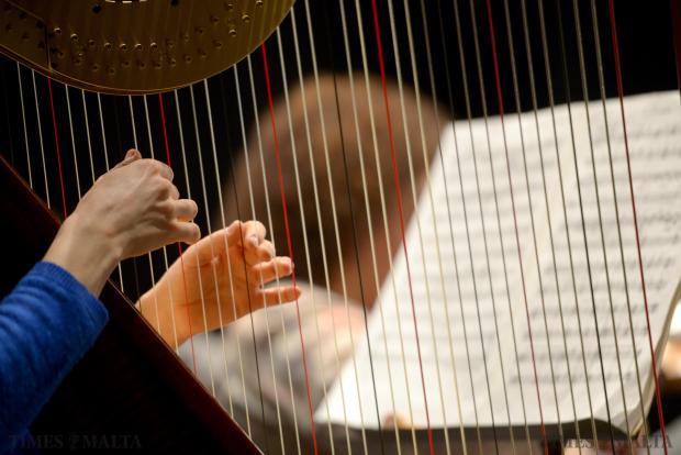 A lady plays her harp under the baton of Peter Stark at the Manoel Theatre in Valletta on January 16, as part of the Valletta International Baroque Festival 2015. Photo: Matthew Mirabelli