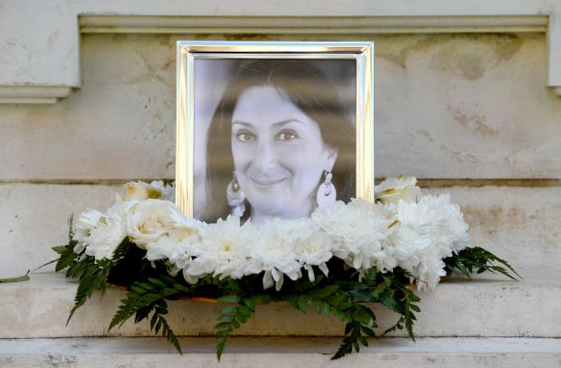 The three men stand accused of assassinating Ms Caruana Galizia (pictured).