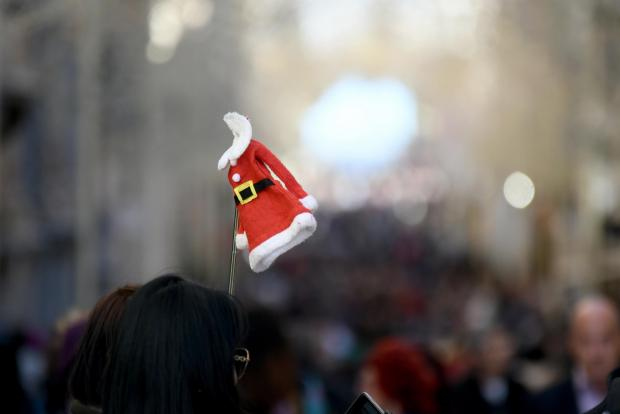 A tiny Father Christmas jacket perched atop a selfie stick makes its way down Republic Street in Valletta. on December 6. Photo: Jonathan Borg